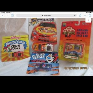 Lot of 4 collector racing die cast cars New in pkg
